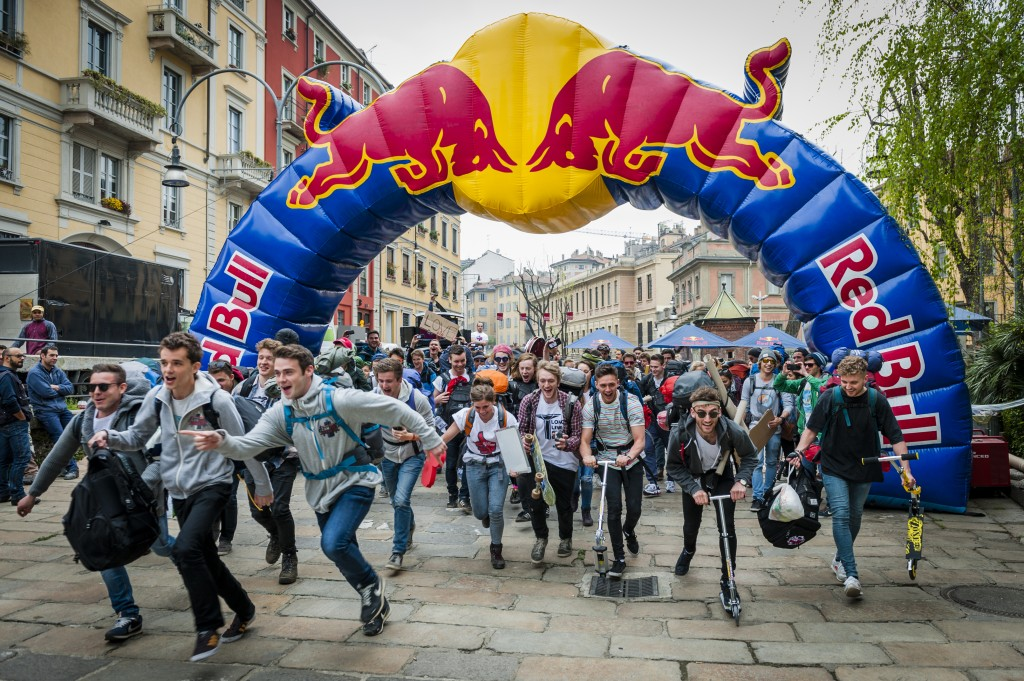 Event participants run at the starting line of Red Bull Can You Make It in Milan, Italy, on April 04 2014